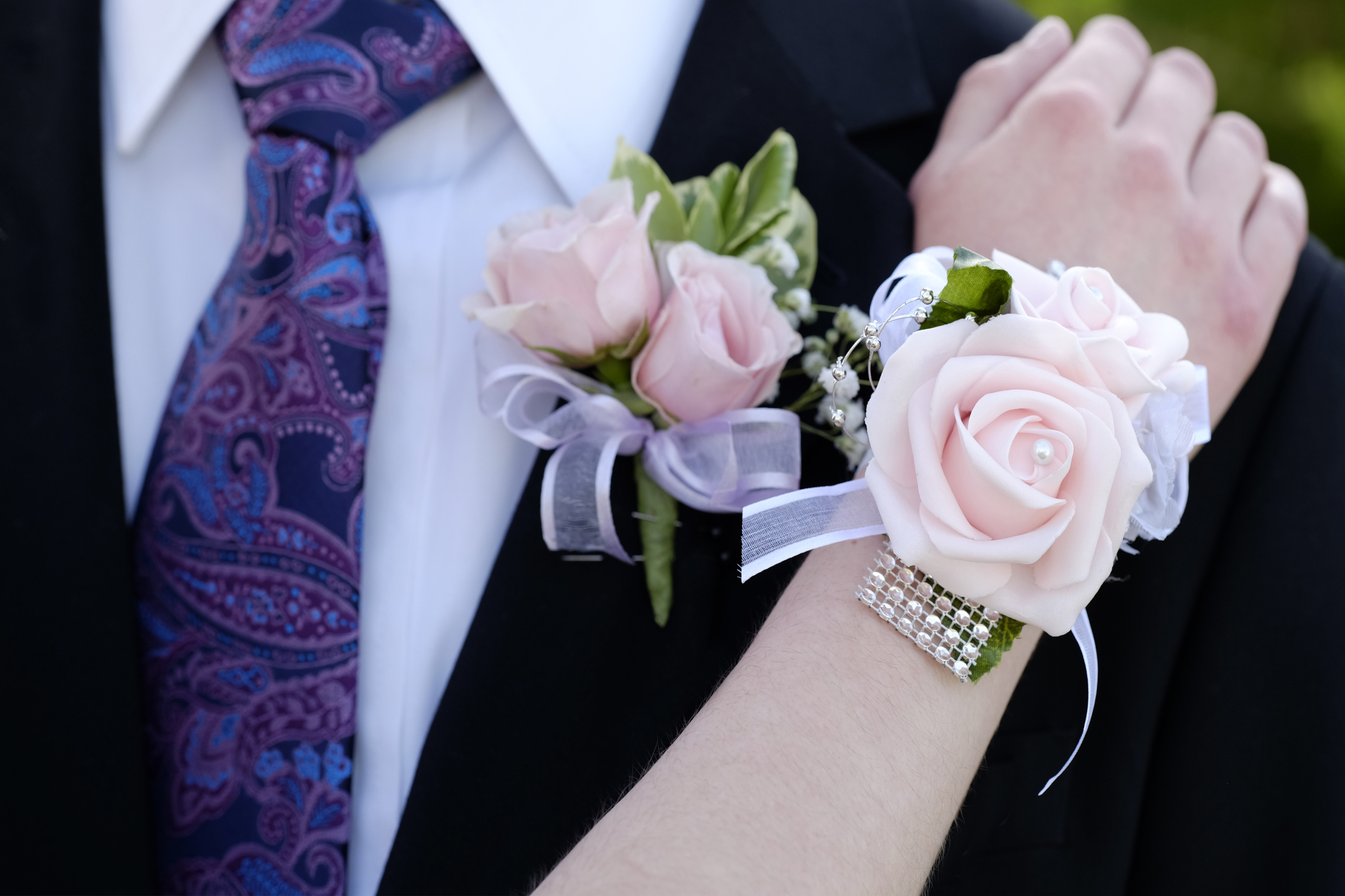 Hands of date Prom night flowers corsage
