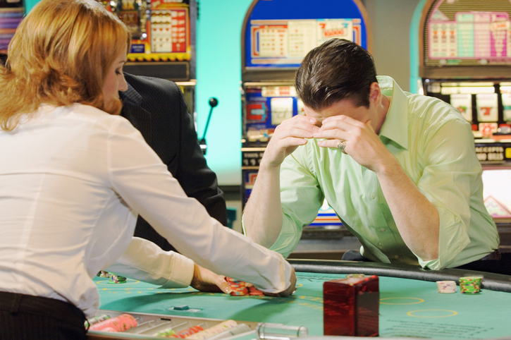 unlucky man at a table during a casino party
